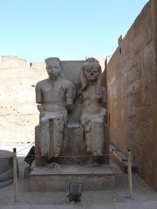 Statue of Tutankhamun and Ankhesenamun at Luxor, hacked at during the damnatio memoriae campaign against the Amarna line of Thutmoside pharaohs. copyright Wikipedia