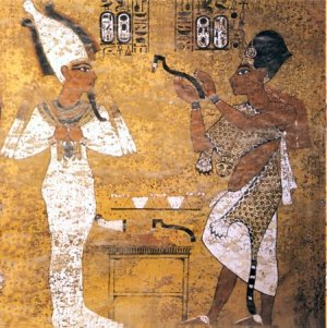 Ay performing the opening of the mouth ceremony for Tutankhamun, scene from Tutankhamun's tomb. Copyright Wikipedia